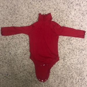 Two toddler onesies with pants.